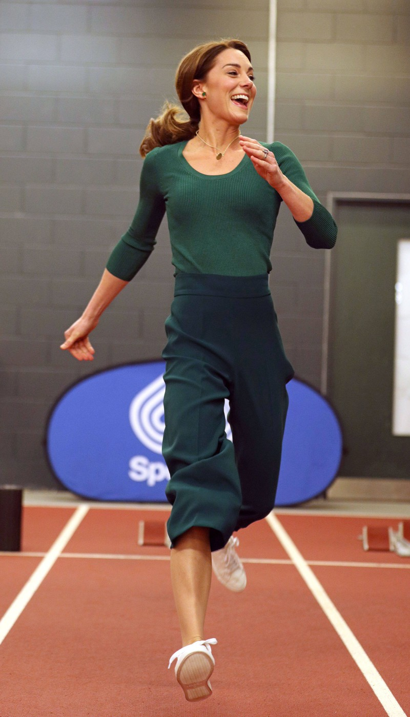 Kate is seen at a sports event and seems to be wearing shape wear.