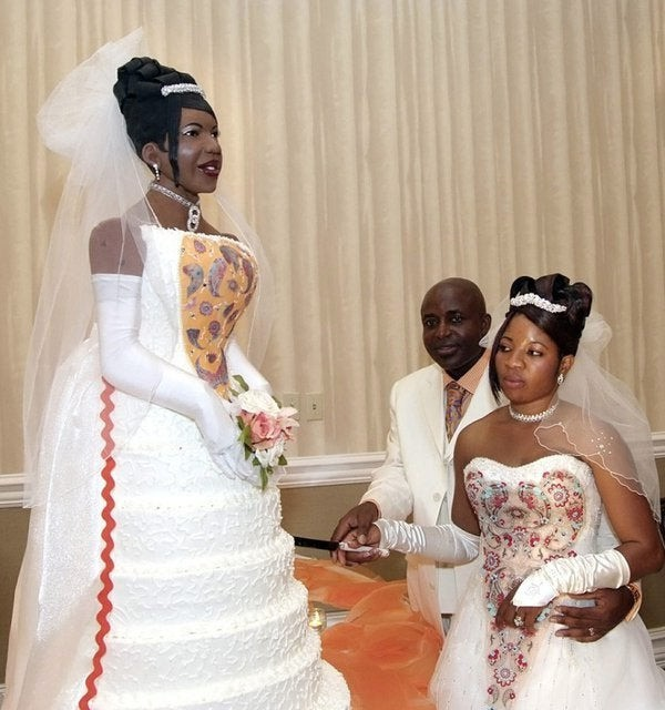 The bride doesn't seem amused by her wedding cake.