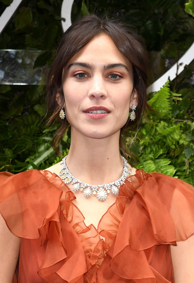 Alexa Chung wears curtain bangs at the Chopard New Store Opening.