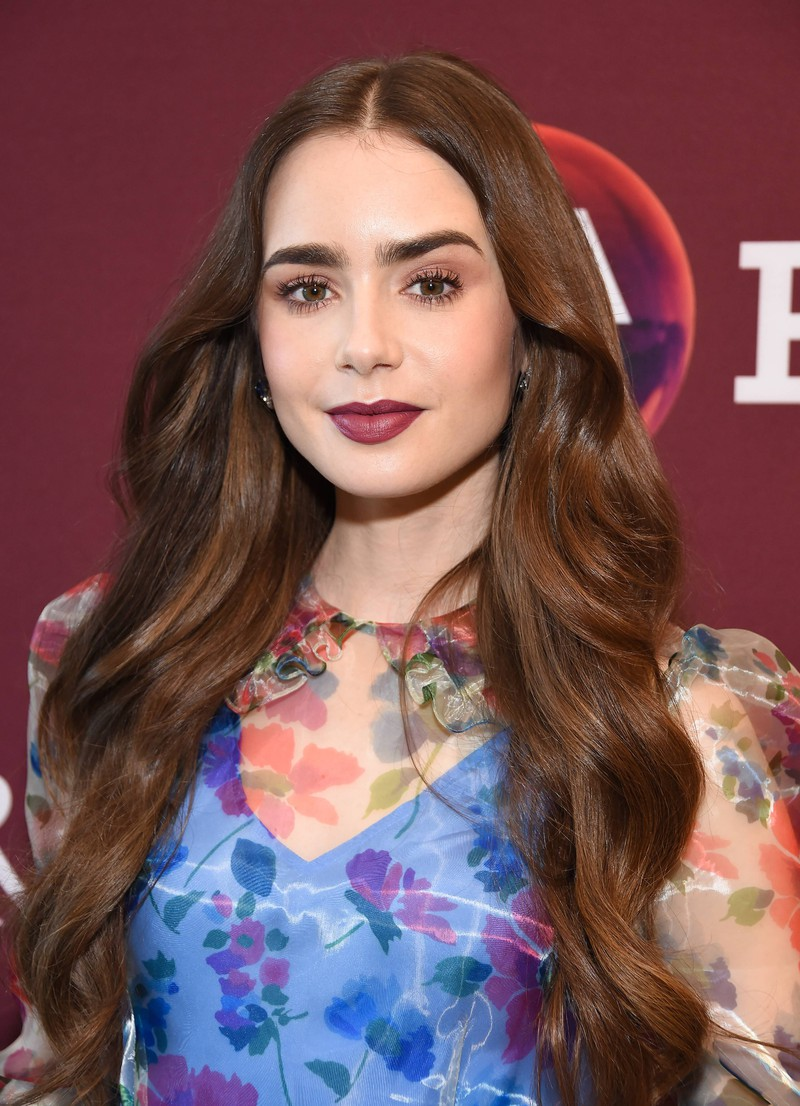 Lily Collins shows us how to wear bold lips.
