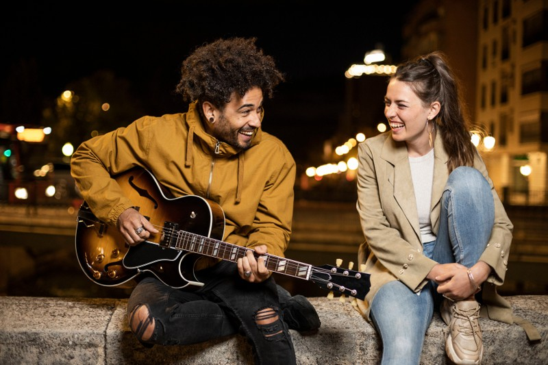 A couple is making music together because they love it and each other.