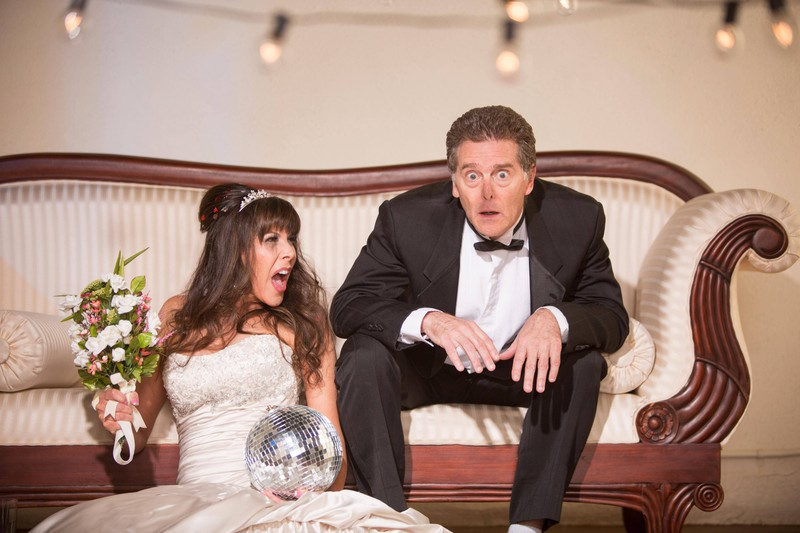An angry bride yells at her husband.