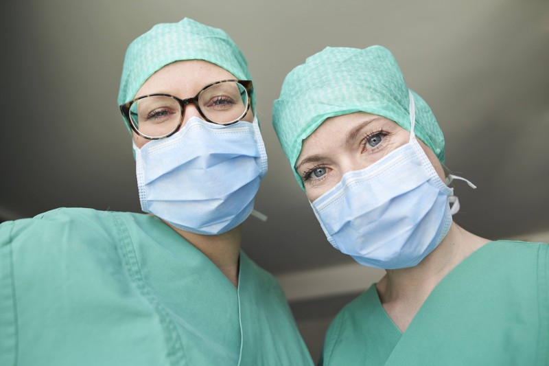 Two doctors ready for surgery.