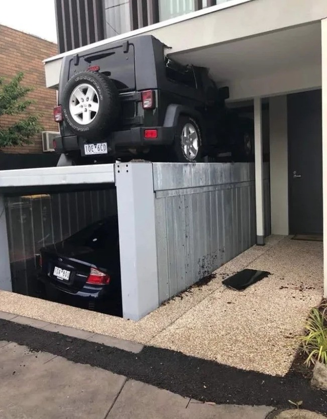 A car was parked on a parking garage and got smashed.