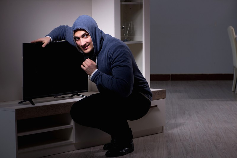 A man breaks into his neighbor's house to use his TV.