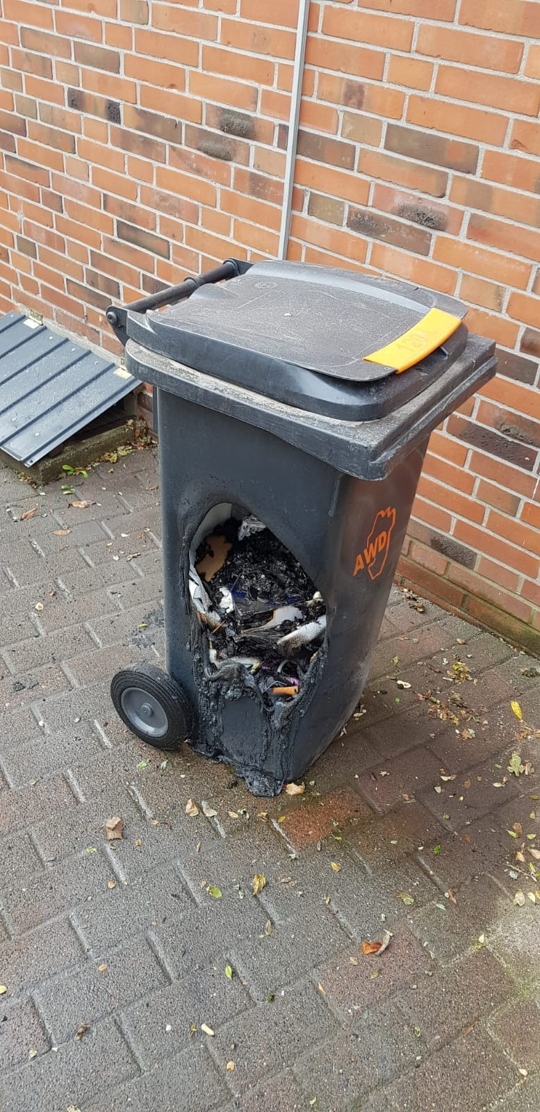 A neighbor destroyed a trashcan by dumping hot charcoal in it.