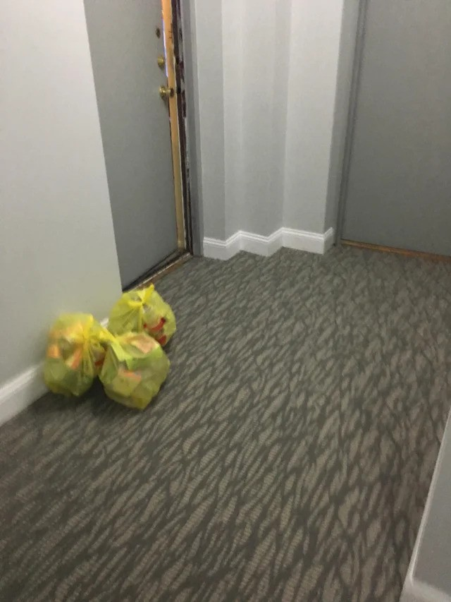 A person dumped his garbage in the hallway.
