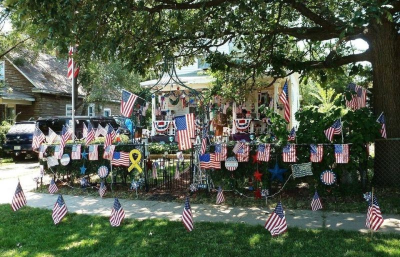 Neighbors decorated their house with a lot of flags.