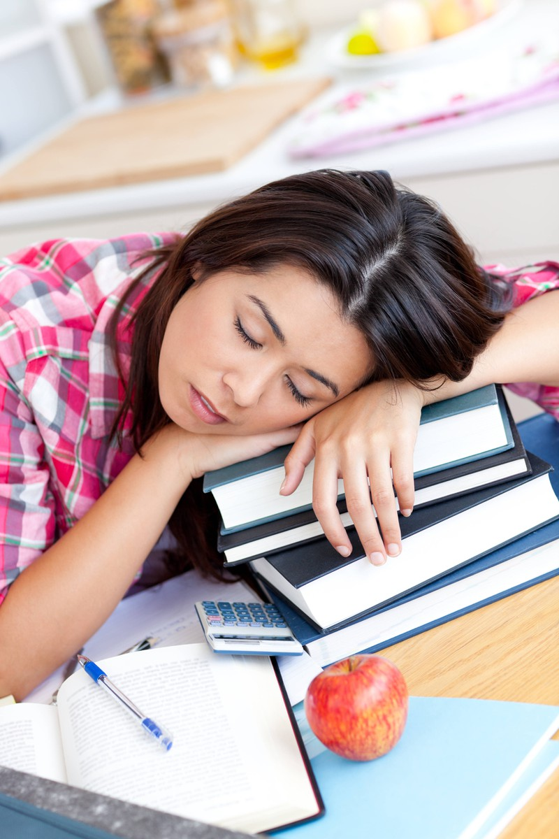 A student sadly thinks she's lazy even though she has a migraine.