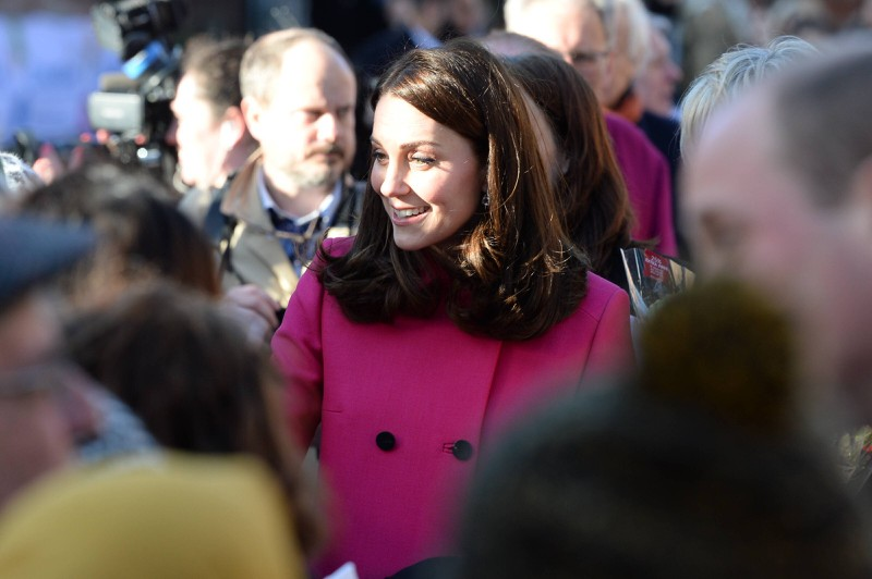 Kate wears a pink coat while visiting Coventry Cathedral.