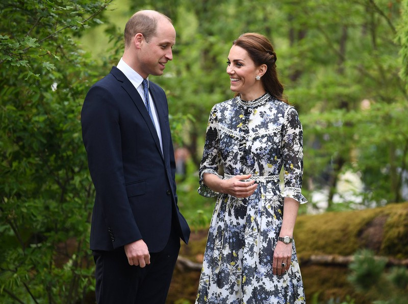 Duchess Kate smiles at Prince Philip who isn't wearing his wedding ring.