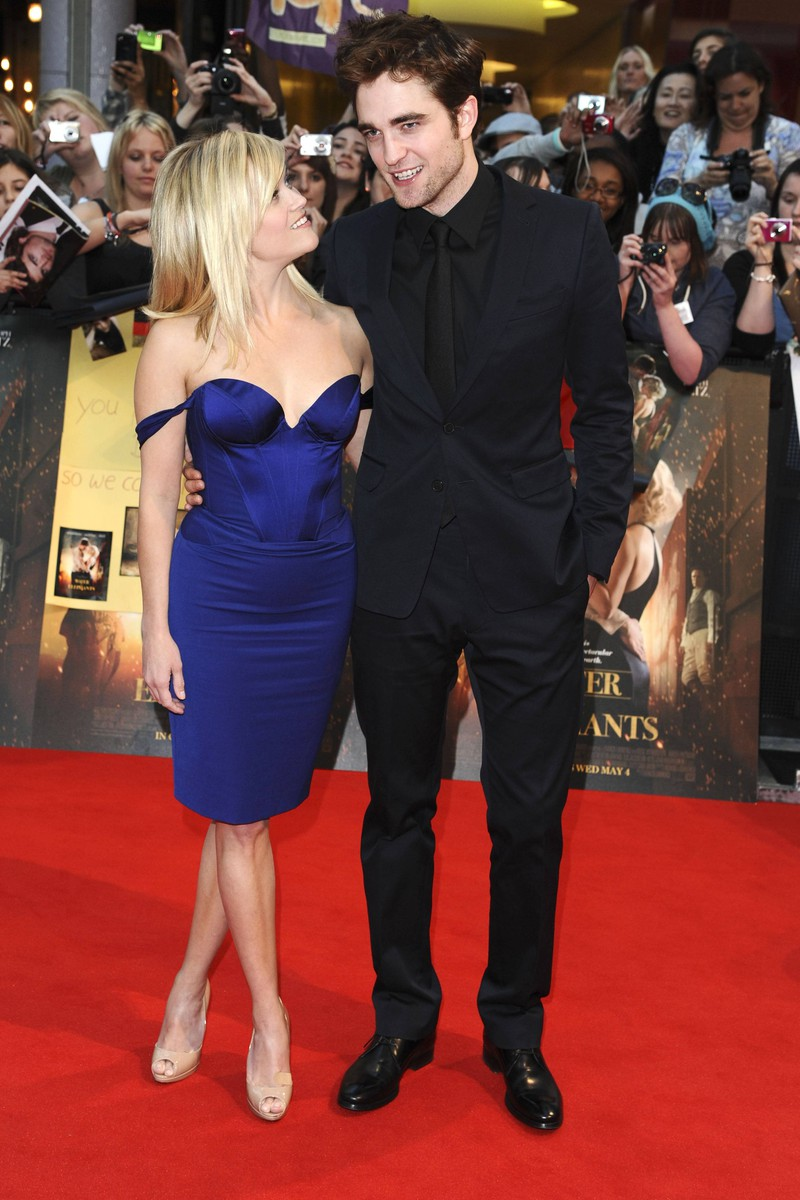 Robert Pattinson was sick while kissing Reese Witherspoon.