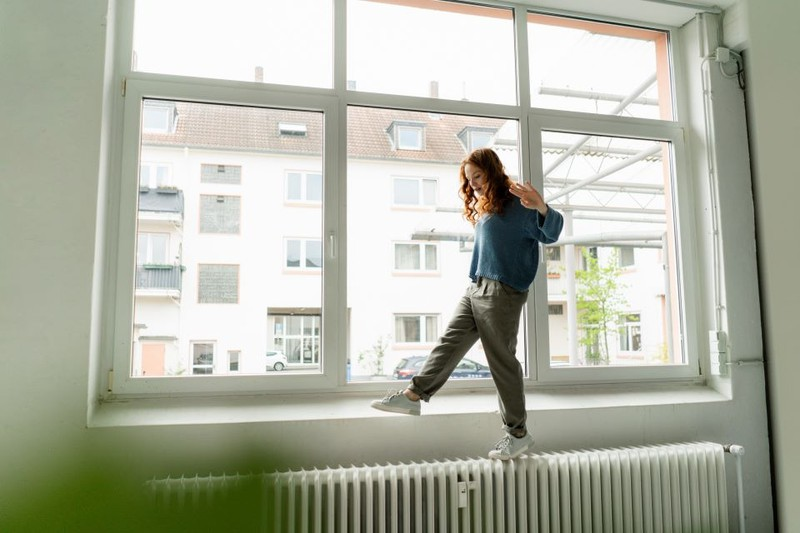 The woman regularly airs her home, that's why condensation doesn't build up on her windows.