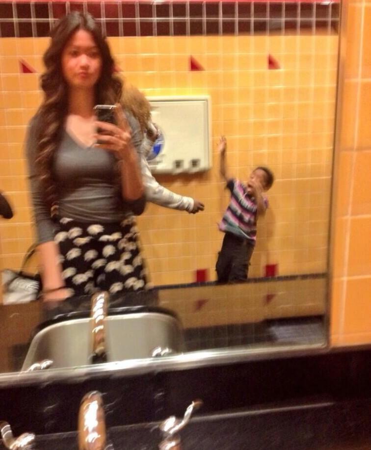 A mother destroying a selfie.