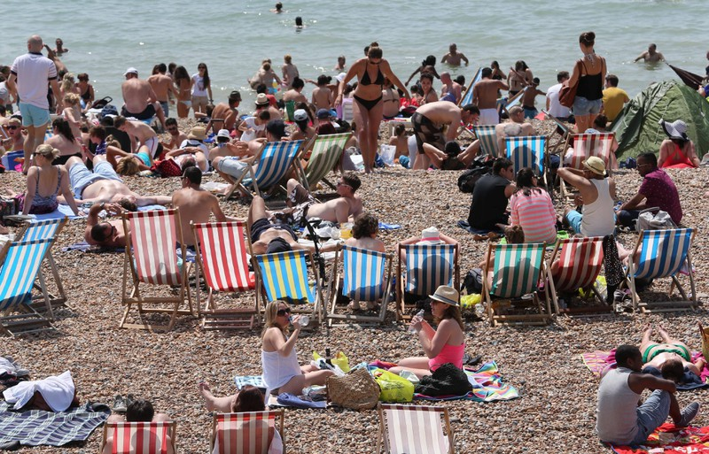 People are trying to escape the heat by going to the beach.