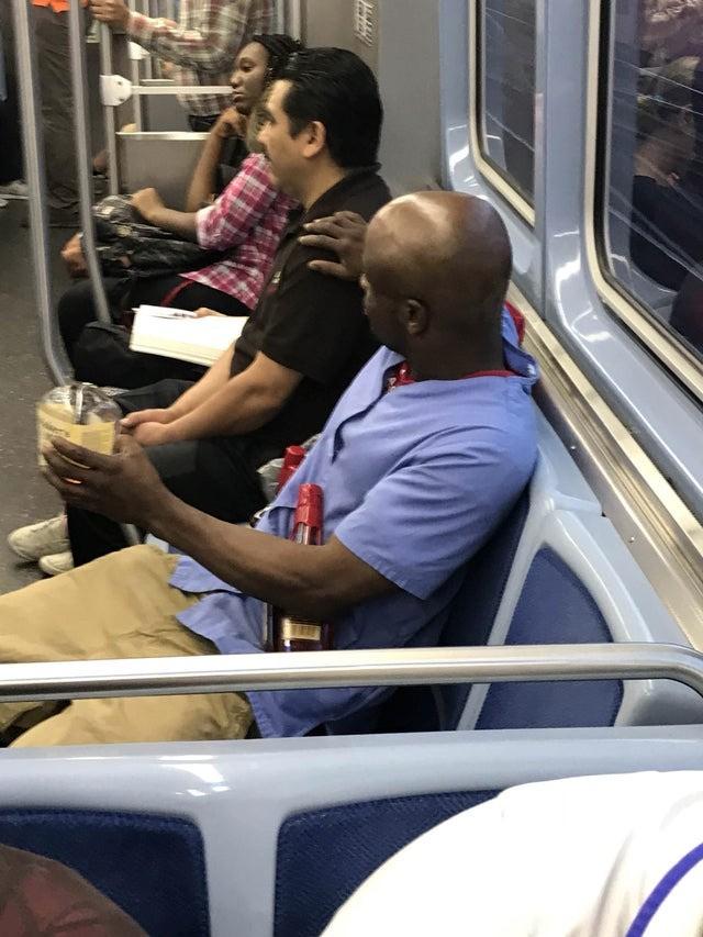 One man is drinking from a broken glass bottle.