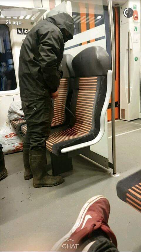 This guy pees on a seat on the underground train.