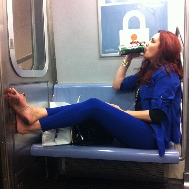 This woman puts up her feet in the subway.