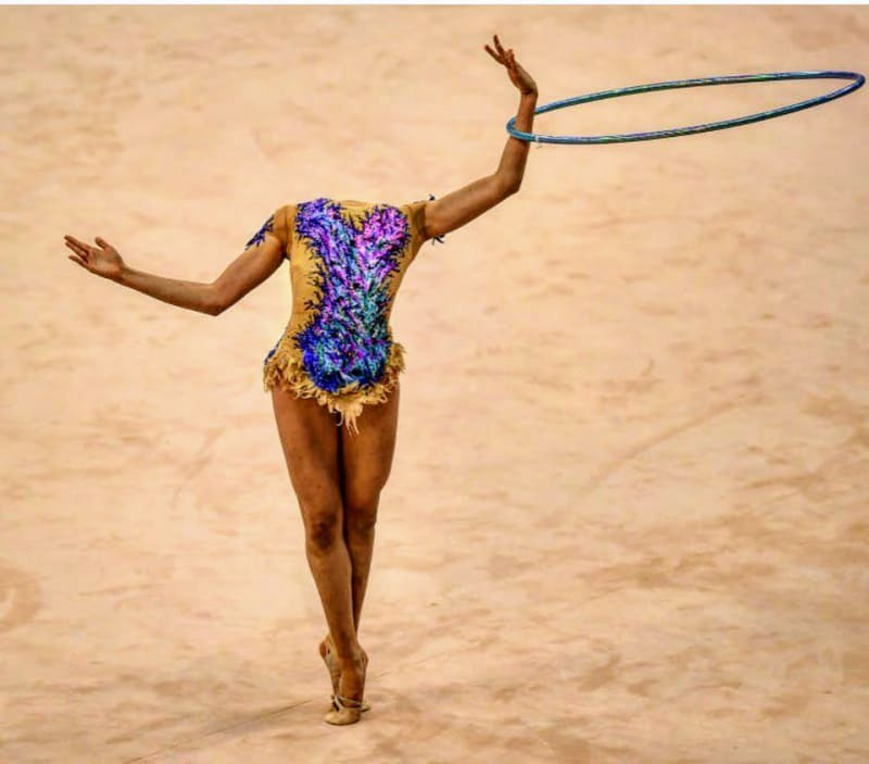 A gymnast with hoola hoops