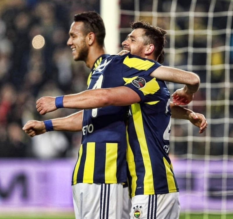 Soccer players embrace