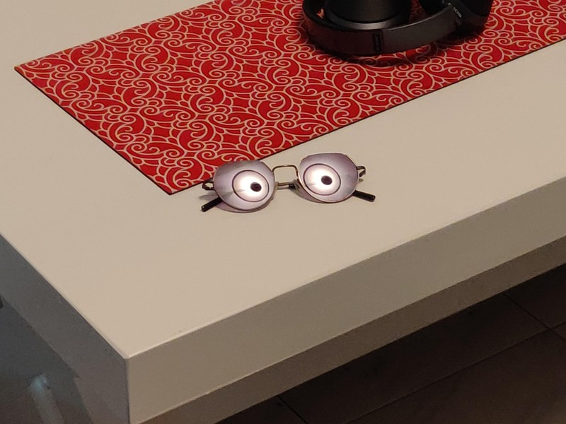 The glasses reflect the light, but it looks like they have eyes.