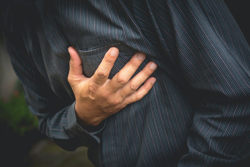 Chest pain can be one sign of having a heart attack.