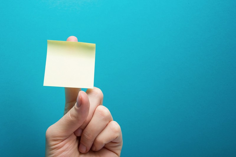 If you tear the Post-it notes from the side, they stay flat longer.