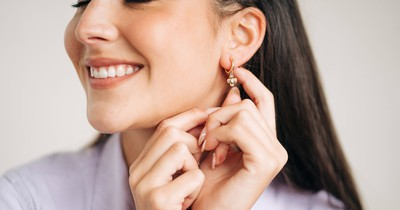 Here's Why Your Ear Piercings Smell Like Cheese