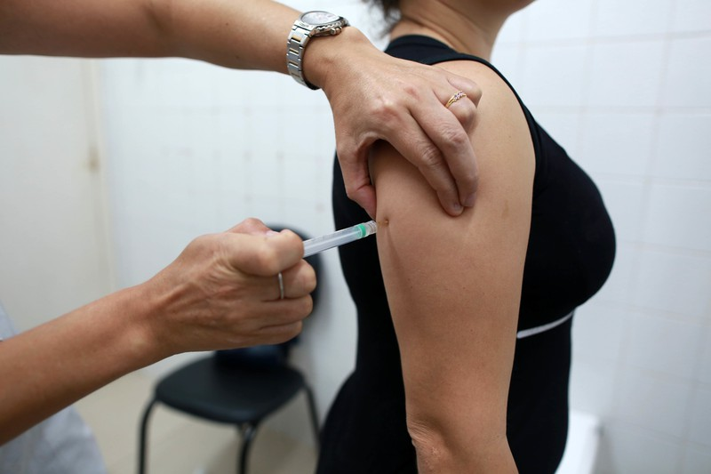 A woman is getting a vaccine.
