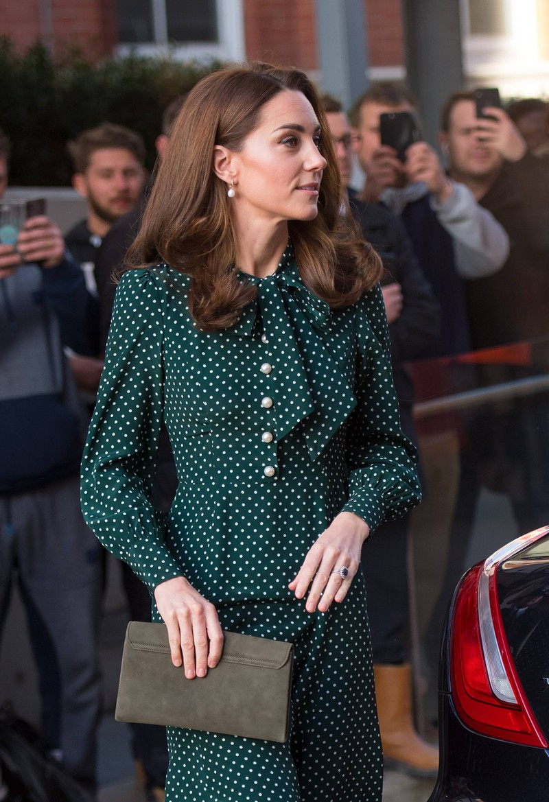 Duchess Kate honors Lady Di in a dark bluish green dress with polka dots.